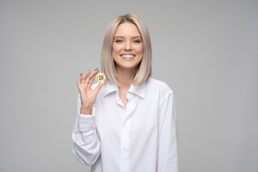 Woman holding bitcoin cryptocurrency